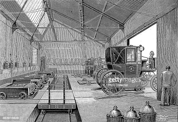 Depot at Rue Cardinet where electrically driven Paris cabs were fitted with freshly charged batteries 1899 At front right are glass carboys in...