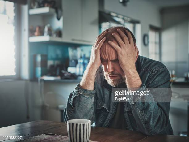 depressed and upset mature man with head in hands - suicide stock pictures, royalty-free photos & images