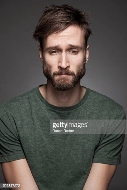 depressed bearded man - disappointment stock pictures, royalty-free photos & images