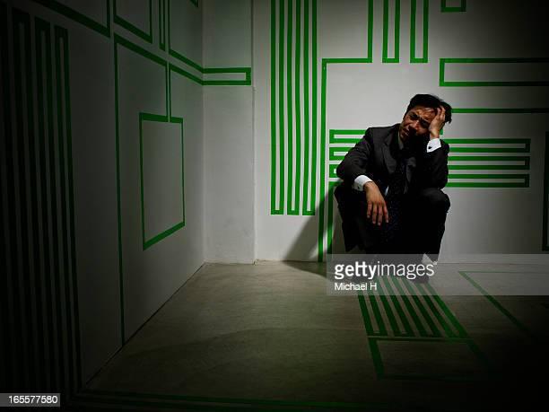 Depressed Business man sitting