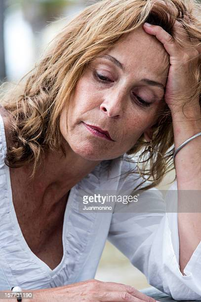Depressed fifty something woman
