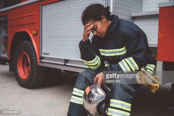 depressed firefighter after rescue operation - paramedic stock pictures, royalty-free photos & images