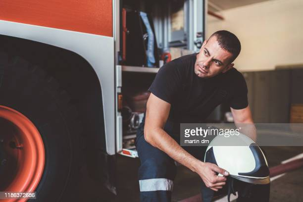 depressed firefighter after rescue operation - fire protection suit stock pictures, royalty-free photos & images