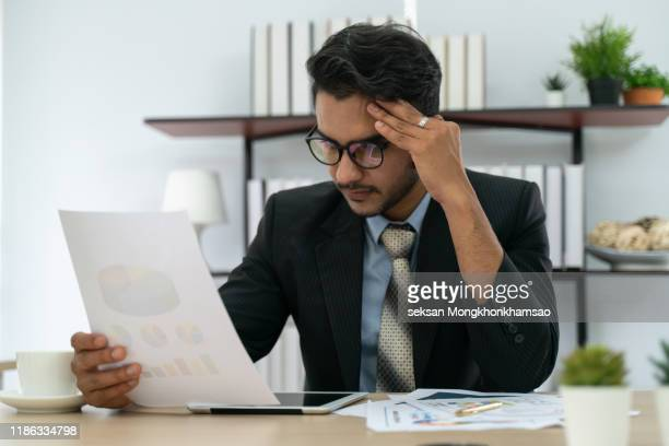 depressed frustrated trader tired of overwork or stressed by bankruptcy - distressed stock market people stock pictures, royalty-free photos & images