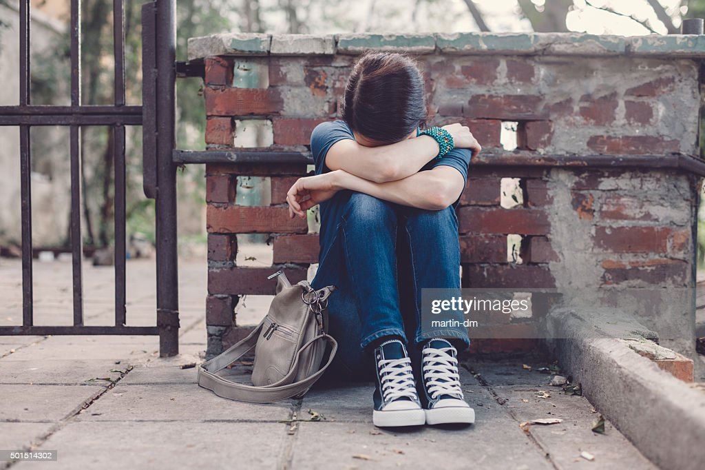 Depressed girl at the street : Stock Photo