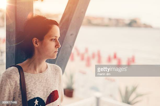 depressed girl at the veranda - post traumatic stress disorder stock pictures, royalty-free photos & images