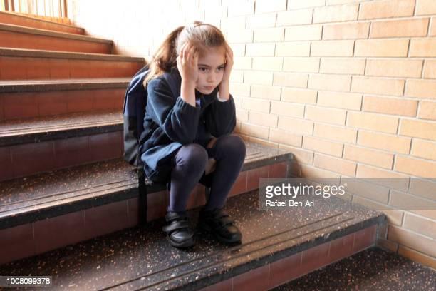 depressed girl in school hallway - rafael ben ari imagens e fotografias de stock