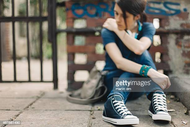 Depressed girl sitting on the ground