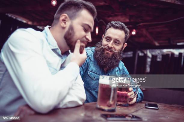 depressed handsome man complaining to his friend about his love problems - complaining stock photos and pictures