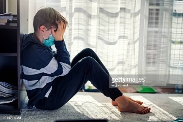 depressed kid during epidemic quarantine - childhood stock pictures, royalty-free photos & images