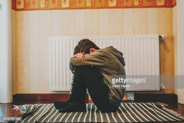 depressed kid during epidemic quarantine - fattigdom bildbanksfoton och bilder