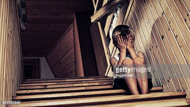 depressed little boy crying. - child abuse stock pictures, royalty-free photos & images