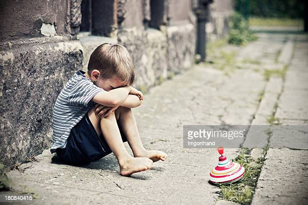 depressed little boy - one boy only stock pictures, royalty-free photos & images
