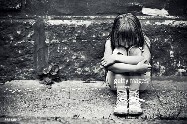 depressed little girl - orphan stock pictures, royalty-free photos & images