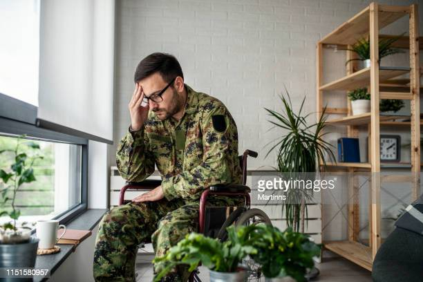 depressed lonely soldier with emotional problem and war syndrome - post traumatic stress disorder stock pictures, royalty-free photos & images