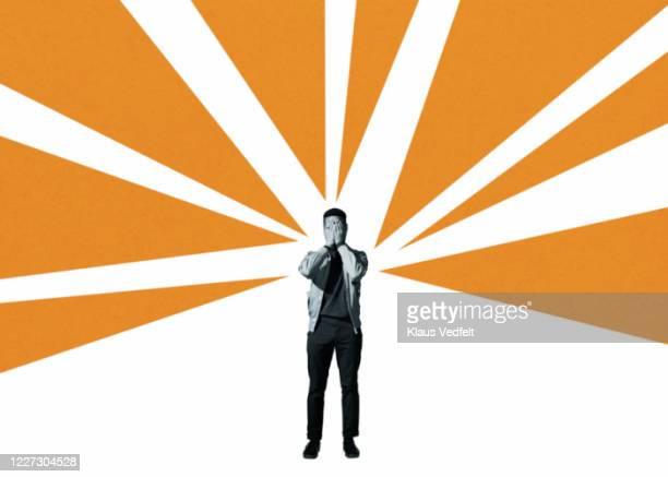 depressed man covering face amidst orange rays - バイアス ストックフォトと画像