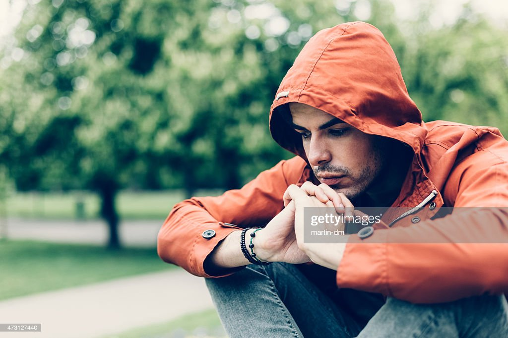 Depressed man in the park : Stock Photo