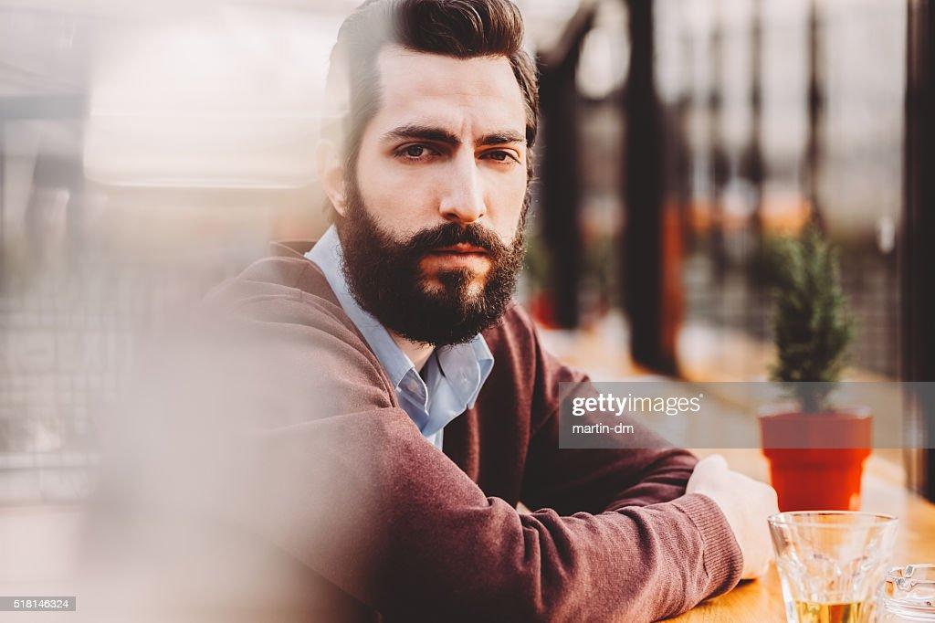 Depressed man looking at camera : Stock Photo
