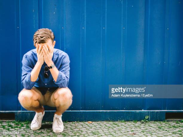 depressed man - head in hands stock pictures, royalty-free photos & images