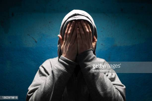 depressed man with hands over face in despair - male bum stock pictures, royalty-free photos & images
