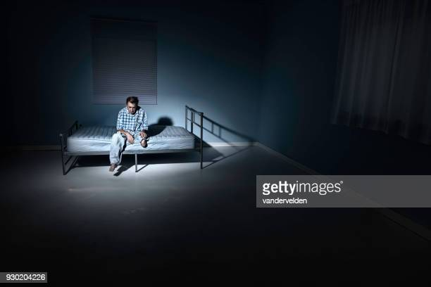 Depressed, one-legged man in his lonely room