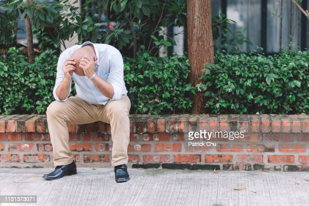 depressed sad regret bald asian indian man hands on head - completely bald stock photos and pictures