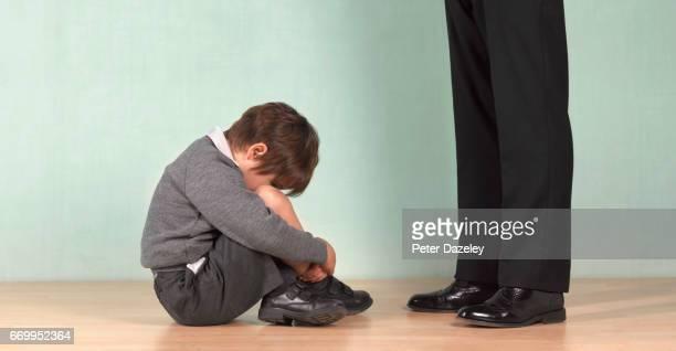 Depressed school boy and teacher