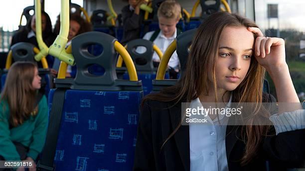 Depressed Schoolgirl Sitting Alone on Bus