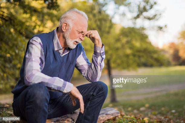 Depressed senior man regreting the past and crying.