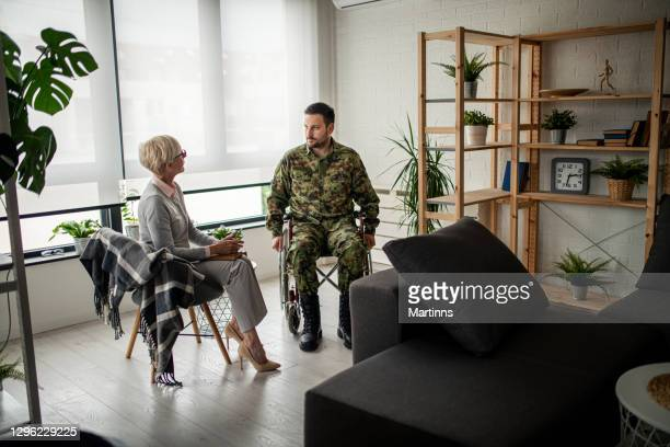 depressed soldier and his psychotherapist during a session - post traumatic stress disorder stock pictures, royalty-free photos & images