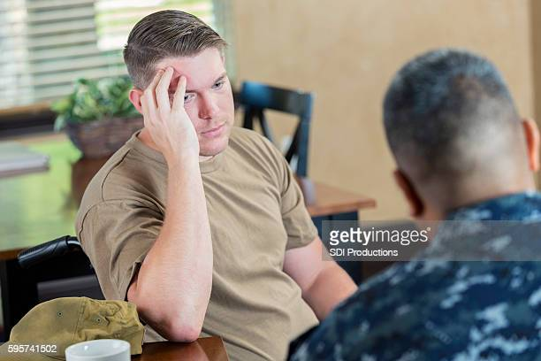 depressed soldier being evaluated by military counselor or doctor - injured soldier stock photos and pictures