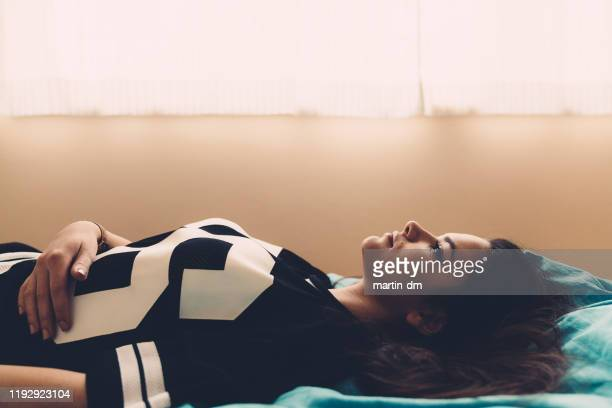 depressed teenage girl lying down in bed - teenagers only stock pictures, royalty-free photos & images