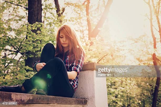 Depressed teenage girl outside