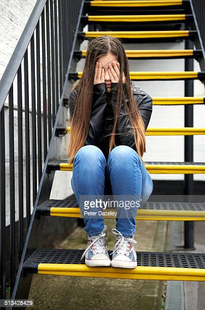 Depressed teenager on steps