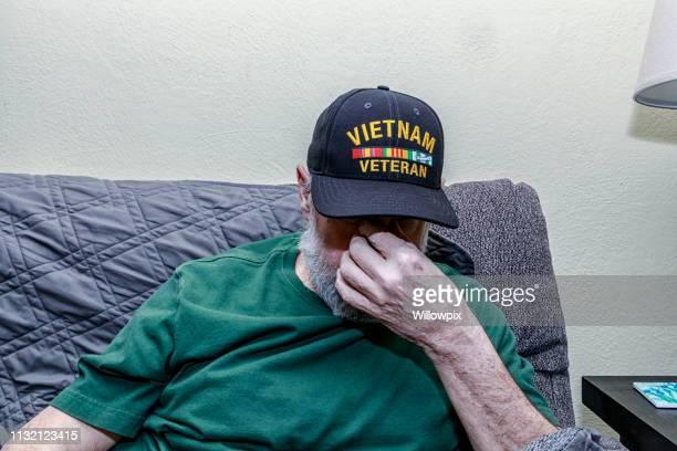 Depressed Vietnam War USA Military Veteran Covering Face