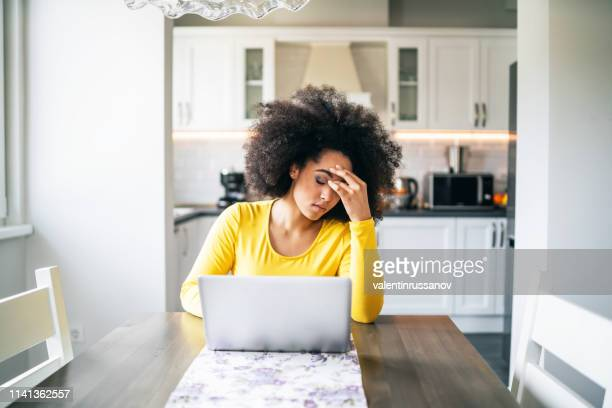 depressed woman at home - emotional stress stock pictures, royalty-free photos & images