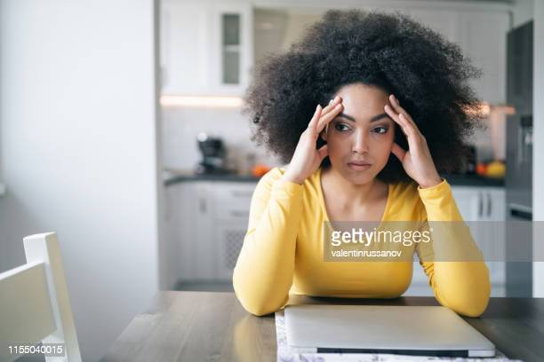 depressed woman at home - surfing the net stock pictures, royalty-free photos & images