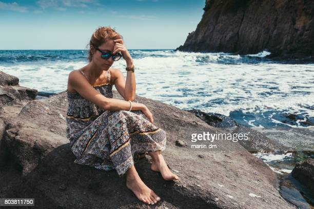 Depressed woman on summer vacation