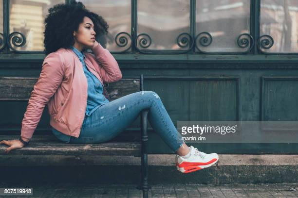depressed woman sitting at bench - broken heart stock pictures, royalty-free photos & images