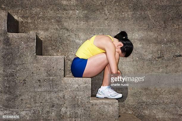 Depressed Woman Sitting on Stairway