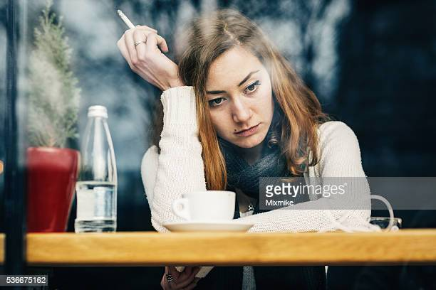depressed young girl - little girl smoking cigarette stock photos and pictures