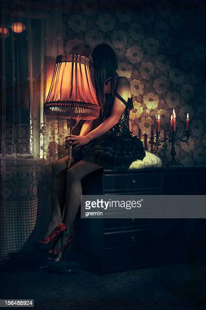 depressed young woman in old room - one young woman only stock pictures, royalty-free photos & images