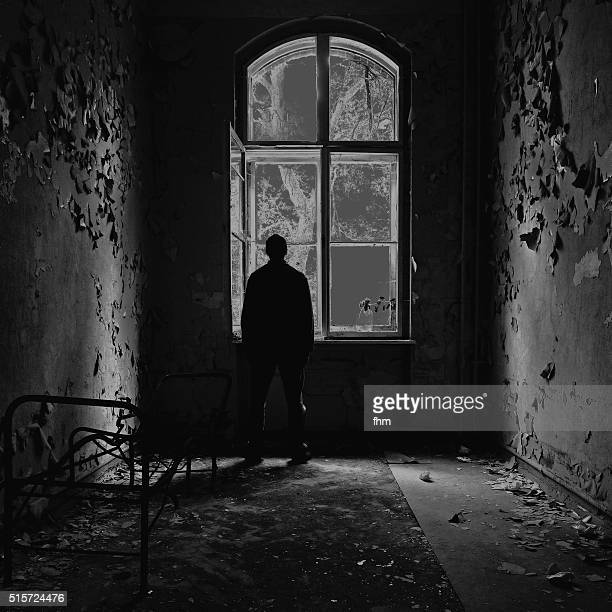 depression - man feeling depressive in an empty room - psychiatric hospital stock pictures, royalty-free photos & images