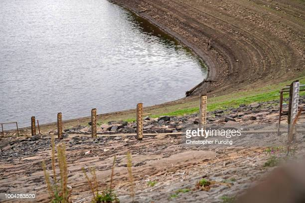 Depth markers show the water depletion of Yarrow reservoir near Bolton as the heatwave continues across the UK on July 23 2018 in Bolton England A...