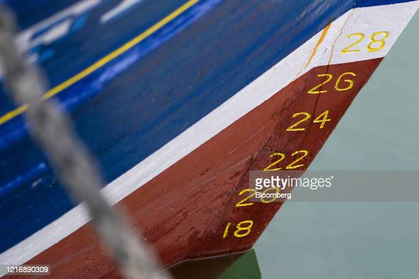 Depth markings sit on the hull of a fishing boat as it sits moored in the harbour in Scarborough UK on Tuesday June 2 2020 The threat of a nodeal...