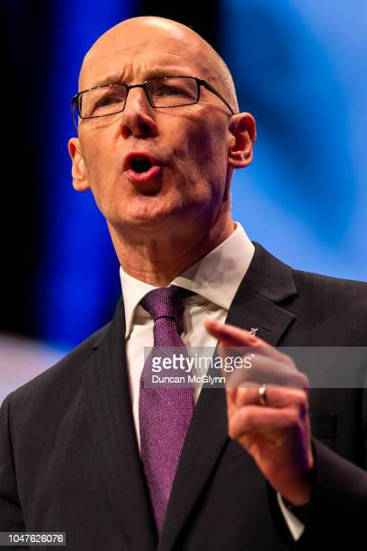 Depute First Minister of Scotland John Swinney MSP makes his keynote speech at the 84th annual SNP conference at the Scottish Exhibition and...