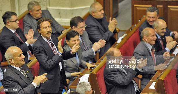 Deputies applaud after voting anticrisis measures on October 31 2008 in Kiev A package of legislation demanded by the International Monetary Fund to...