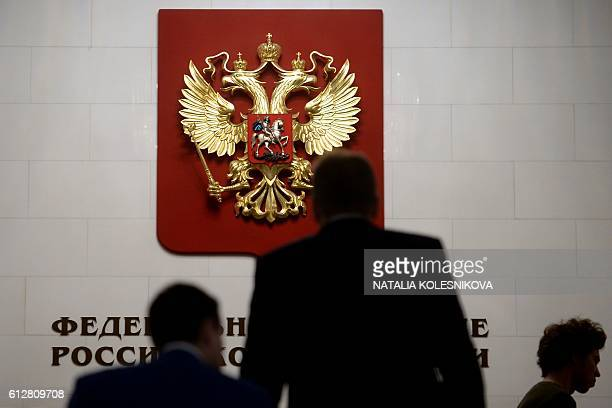 Deputies arrive for the opening session of the newly elected State Duma Russia's lower house of parliament in Moscow on October 5 2016 / AFP /...
