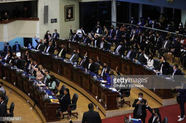 Deputies belonging to the ruling Nuevas Ideas party vote to dismiss a group of judges during the first plenary session of the Legislative Assembly in...