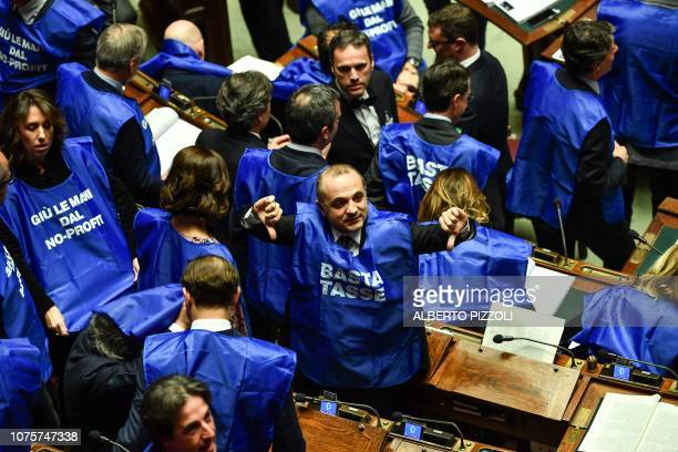 Deputies from the centreright party Forza Italia wearing blue vests reading Enough taxes and Hands off non profit disrupt a session for a Parliament...